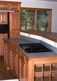 Kitchen island with down draft cook top