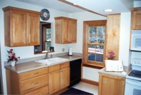 Remodeled kitchen with maple Merillat cabinets and a new pass-through to the dining room